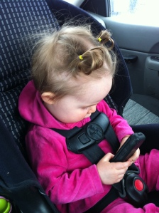 My daughter Chloe trying to figure out how the touch screen on this flip phone works...